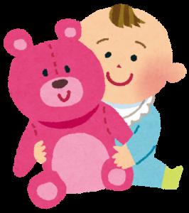 赤ちゃんとクマのぬいぐるみ